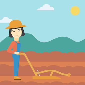 Agriculteur sur le terrain avec charrue