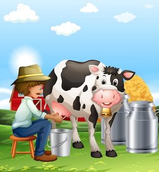 Agriculteur trayant une vache dans la journée