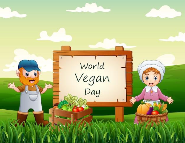 Les agriculteurs debout à côté du texte de la journée mondiale du végétalien