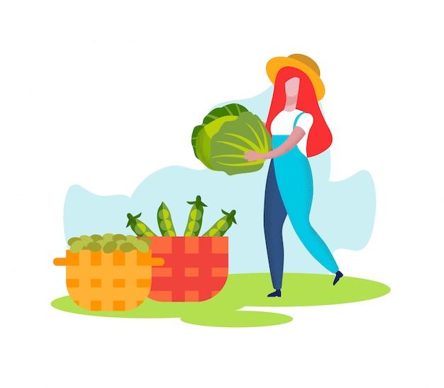 Une agricultrice porte un chou au panier, la récolte