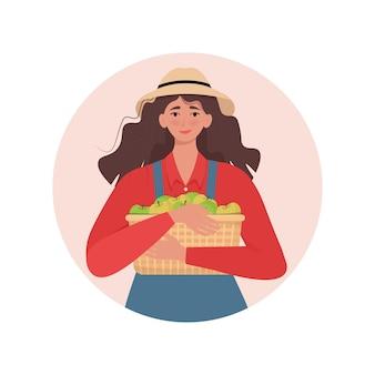 Agricultrice tenant un panier en osier avec des pommes illustration vectorielle dans un style plat