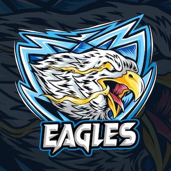 Un aigle avec l'œil du feu comme logo ou mascotte et symbole esport