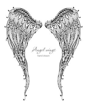 Ailes d'ange ornées dessinées à la main de vetor, style zentangle