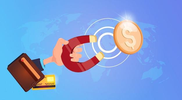 Aimant à main tirant des pièces d'un dollar vers un sac à main accumulation réussie de richesse