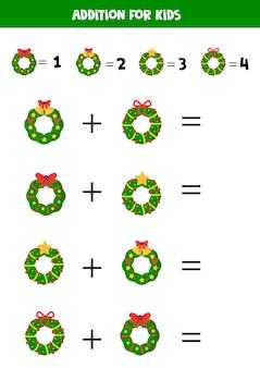Ajout avec des couronnes de noël. feuille de calcul mathématique pour les enfants.