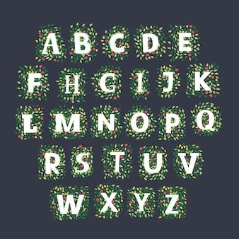 Alphabet dessiné à la main composé de feuilles et de fleurs de printemps et de suumer sur fond sombre