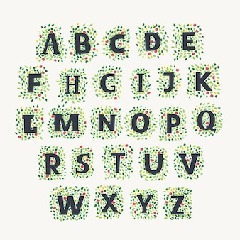 Alphabet dessiné à la main avec des feuilles et des fleurs de printemps et de sumer sur fond blanc