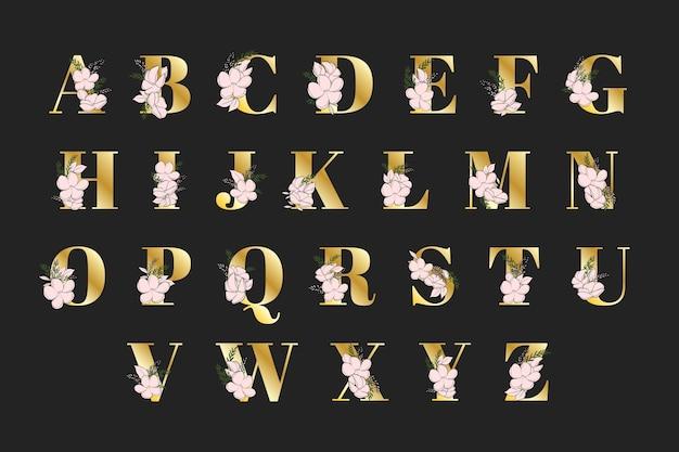 Alphabet doré avec des fleurs élégantes