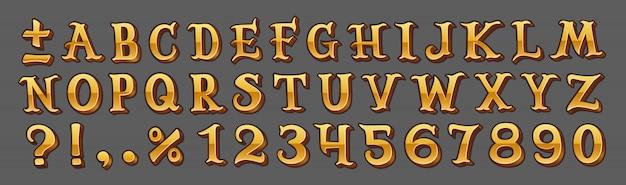 Alphabet doré isolé sur gris