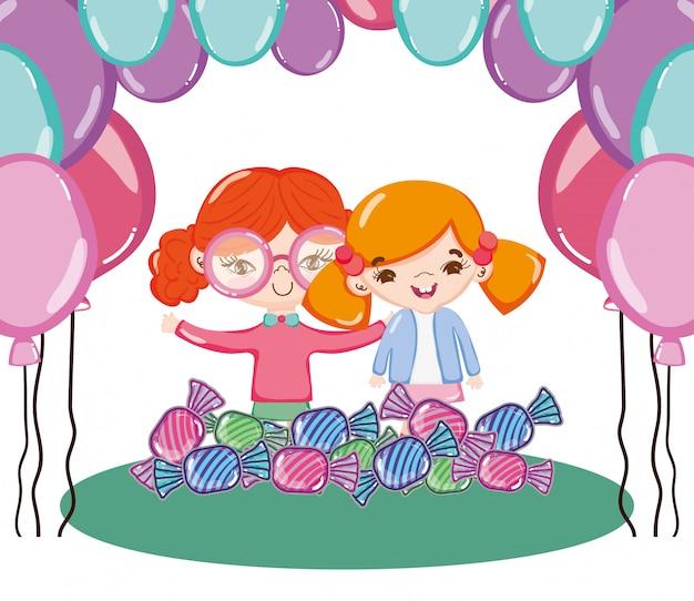Amies filles avec des ballons et des bonbons sucrés