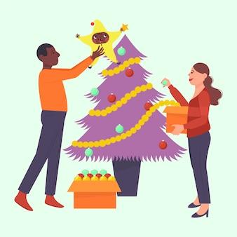 Amis décorer un arbre de noël