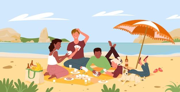 Amis sur la plage pique-nique dans le paysage de bord de mer d'été, jouant à un jeu de cartes amusant