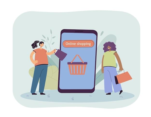 Amis avec des sacs achetant des vêtements en ligne