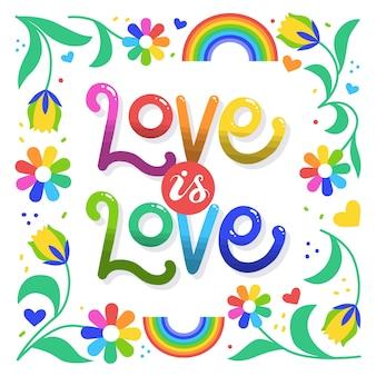 L'amour est le lettrage et les fleurs de jour de fierté d'amour