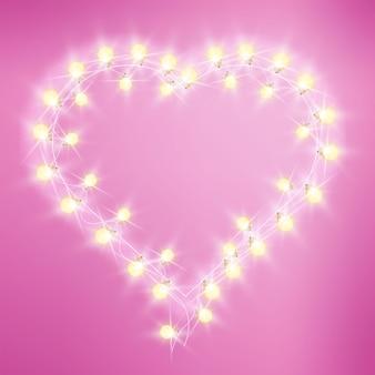L'amour en forme de coeur de la saint-valentin s'allume sur fond rose avec ampoules, guirlande.