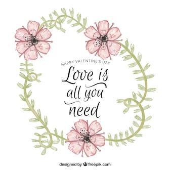 L'amour phrase avec des détails floraux d'aquarelle