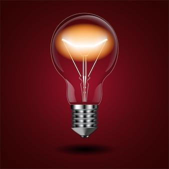 Ampoule éclairée avec une lueur de bobine sur rouge
