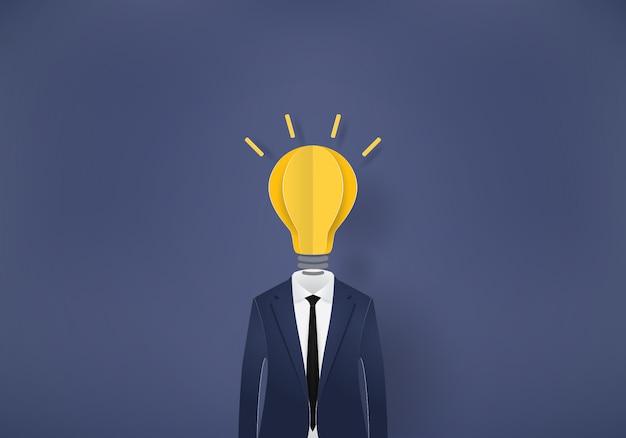 Ampoule homme d'affaires, papier découpé