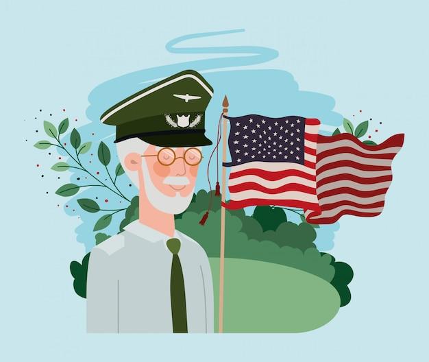Ancien militaire avec drapeau américain sur le terrain