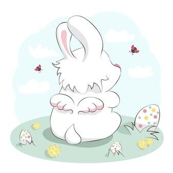 Ange de lapin mignon avec des ailes et des oeufs de pâques. illustration dessinée à la main de dessin animé