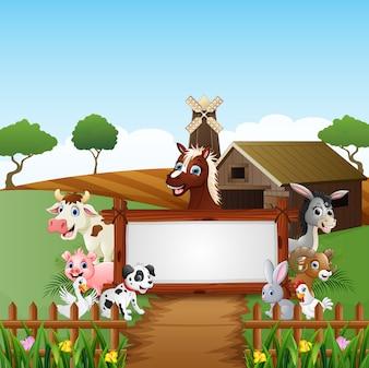 Animaux de la ferme avec un signe vierge en bois