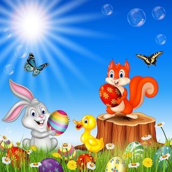 Animaux de dessin animé avec la nature fond de pâques