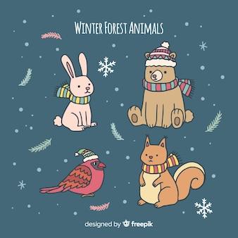 Animaux dessinés à la main dans la forêt d'hiver