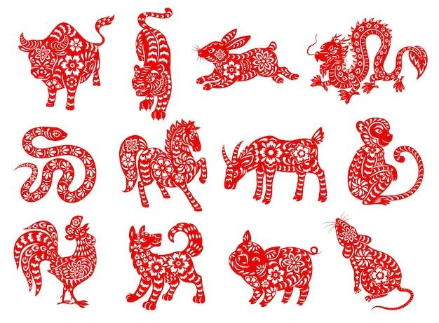 Animaux du zodiaque chinois découpés en papier rouge