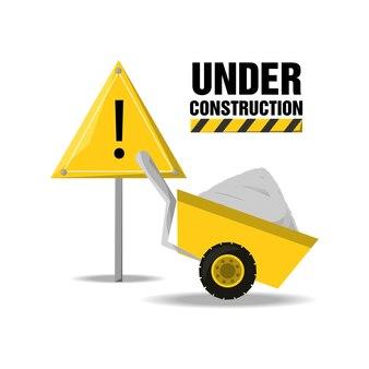 Appartement en construction avertissement et chariot avec ciment