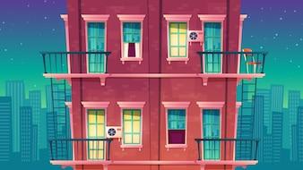 Appartement résidentiel de plusieurs étages la nuit, bâtiment privé