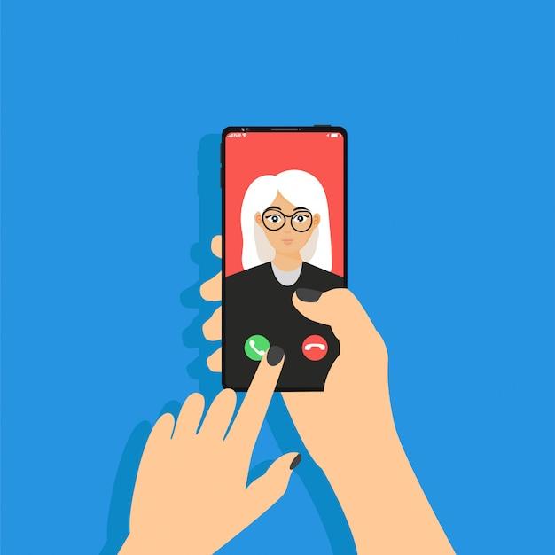 Appel entrant sur le téléphone qui est dans la main. main tient le téléphone, l'écran tactile du doigt. service d'appel.