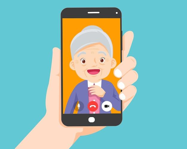 Appel vidéo sur smartphone avec les grands-parents