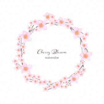 Aquarelle de couronne florale avec de belles fleurs de cerisier japonais