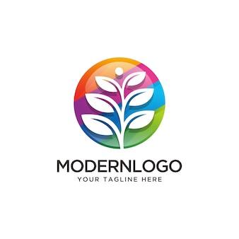 Arbre coloré en cercle logo