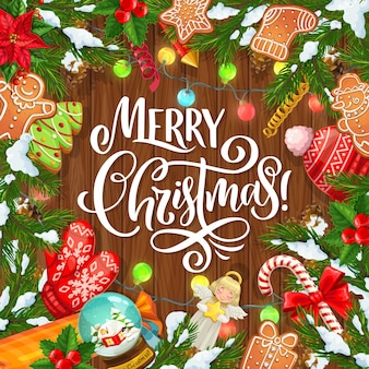 Arbre de noël, cadeaux de noël et branches de pin et de houx sur fond de bois. cadeaux de vacances d'hiver, cannes de bonbon et neige, pain d'épice, ange avec étoile, lumières et flocons de neige