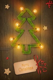Arbre de noël sur fond en bois foncé, souhaits, étoiles en bois.