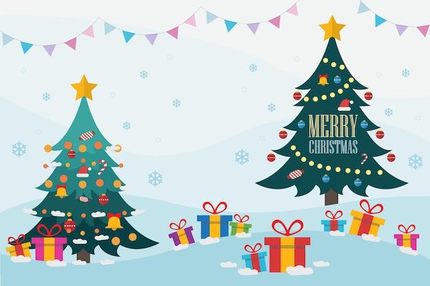 Arbres de noël avec des cadeaux sur la neige et illustration de lettrage joyeux noël