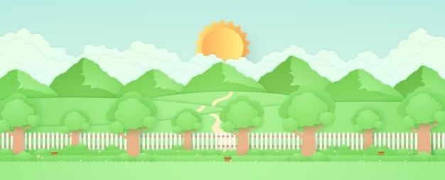 Arbres de paysage de printemps dans le jardin avec des pots de plantes belles fleurs sur l'herbe et la clôture