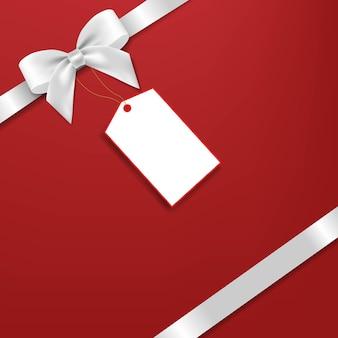 Arc en argent avec étiquette cadeau