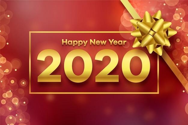 Arc cadeau doré 2020 et arrière-plan flou