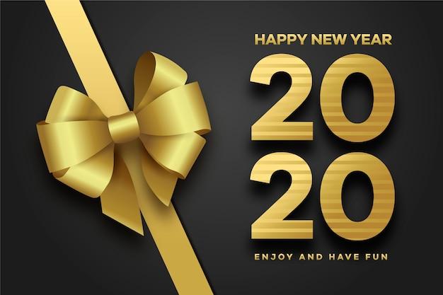 Arc cadeau doré pour la nouvelle année 2020