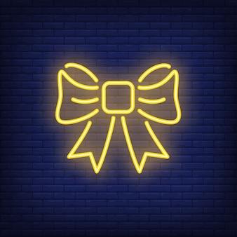 Arc de cadeau jaune néon. élément de signe lumineux de nuit. illustration pour les vacances, boîte actuelle