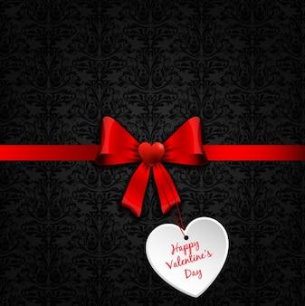 Arc rouge avec une étiquette de la saint-valentin