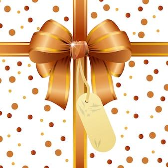 Arc de ruban d'or avec carte de tag