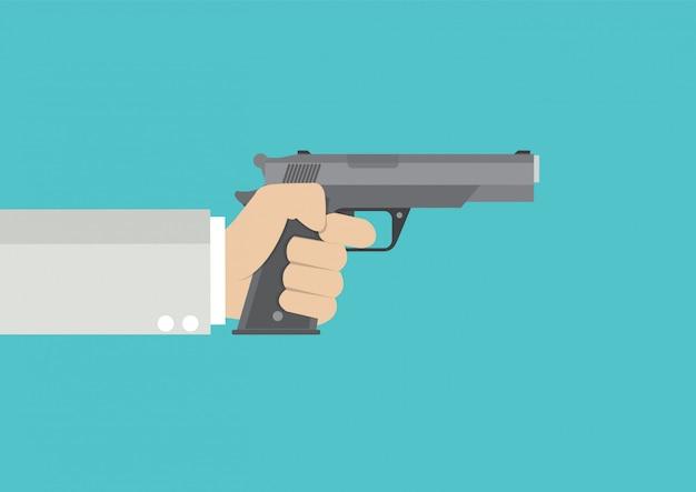 Arme à feu à la main.
