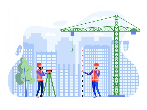 Des arpenteurs-géomètres effectuent des levés sur le site de construction à l'aide de théodolite et d'instruments de mesure.