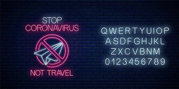 Arrêtez l'enseigne au néon de coronavirus avec pas de symbole de voyage avec alphabet. symbole d'avertissement du virus covid-19 dans un style néon