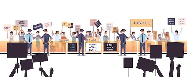 Arrêtez la haine asiatique. personnes tenant des affiches contre le racisme. soutien pendant la pandémie de coronavirus covid-19