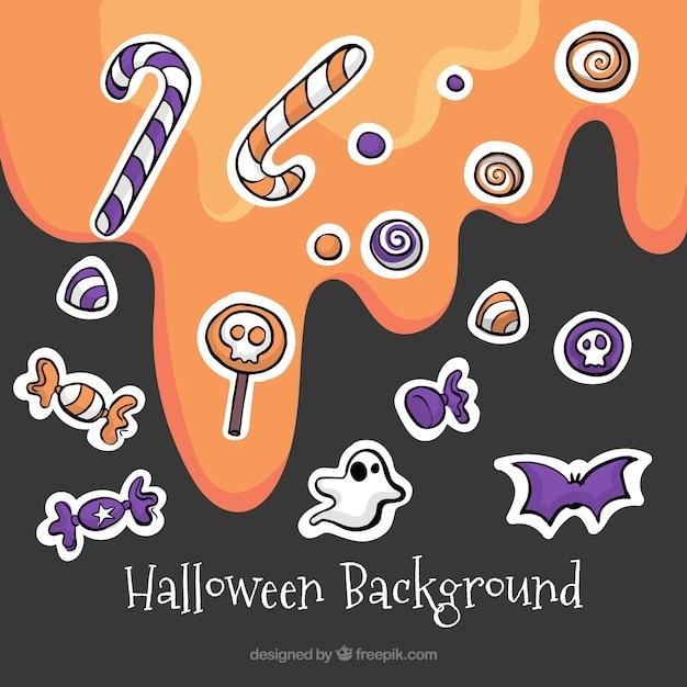 Arrière-plan avec différents bonbons pour halloween