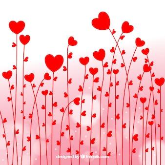 Arrière-plan de fleurs rouges coeurs